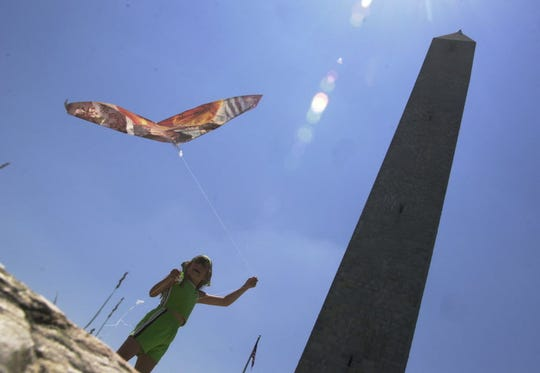 Kaila Yezuita, 8, flying her kite near the High Point Monument in High Point State Park
