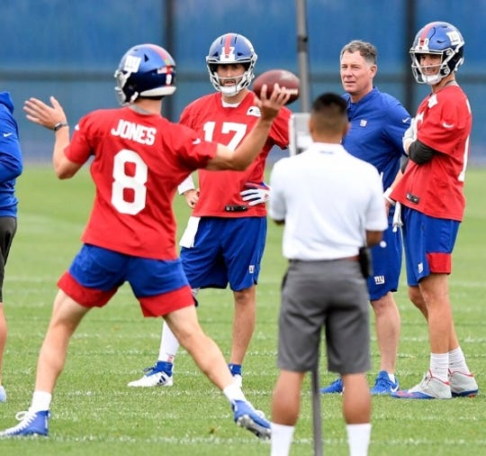 New York Giants rookie quarterback Daniel Jones (8) throws the ball as (from right) starting QB Eli Manning, head coach Pat Shurmur and reserve QB Kyle Lauletta (17) look on during the fourth day of OTAs on Tuesday, May 28, 2019, in East Rutherford.