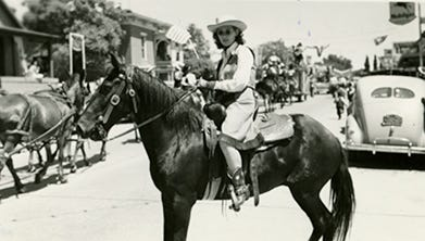"From the exhibit Ranching in Grant County: ""Cowgirl in Parade, 1940."" The rodeo used to be held on July 4th. Many rodeo contestants also participated in the parade."