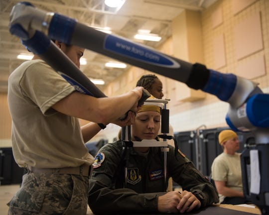 An Airman gets her head measured at the Female Fitment Event at Joint Base Langley-Eustis, Va., June, 4, 2019. The purpose of the event was to take the measurements of female aviators to use when designing female flight equipment prototypes.