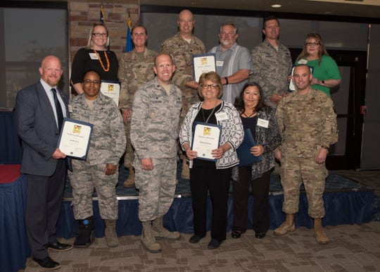 Commanders and honorary commanders from the 49th Mission Support Group pose for a photo, May 31, 2019, on Holloman Air Force Base, N.M. The honorary commander program establishes and maintains personal relationships with local civic leaders, and aids in increasing public awareness of the missions, policies and programs of the Department of Defense and United States Air Force.