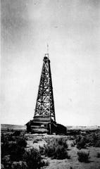 The first commercial gas well in New Mexico is pictured just south of Aztec in 1921.