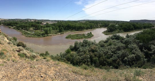 The confluence of the Animas and San Juan rivers is pictured, Monday, June 10, 2019, in Farmington. Some flooding can be seen in Among the Waters Park.