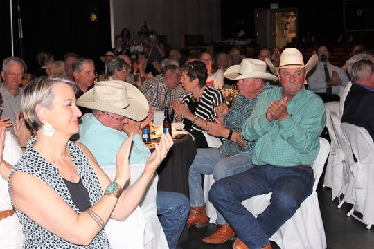 Guests applauded winners at the auction for the Taste of Spencer Fundraiser.