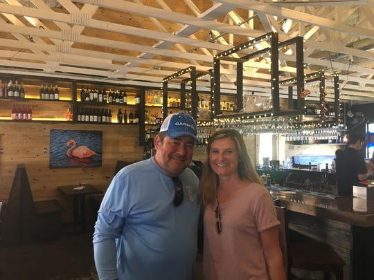 Emeril Lagasse takes a photograph with Pensacola restaurant owner Holly Hays  Sunday at South Market.
