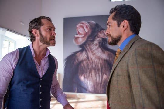 "Jude Law (left) and Demián Bichir star in ""Dom Hemingway."""