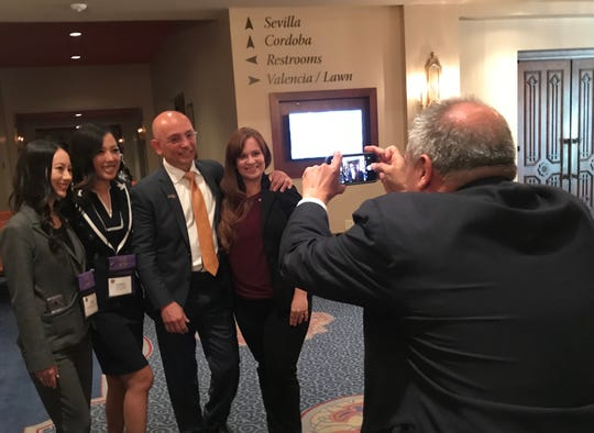 Hotel Impossible host Anthony Melchiorri takes pictures at the Omni Montelucia  with members of the Les Clefs d'Or USA.