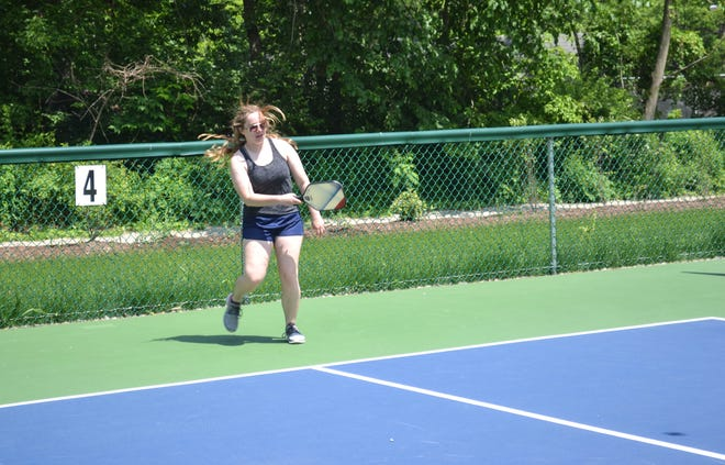 Amber Foster returns a serve during a pickleball match with her mother, Brenda Foster, at the new Hubbard Pickleball Center at Lakeside.