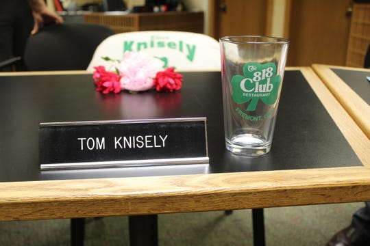 Fremont City Council members left a glass from the 818 Club, flowers and a campaign t-shirt in Councilman Tom Knisley's chair Thursday in honor of the councilman. Knisely died last week at the age of 77 after serving two terms on city council.