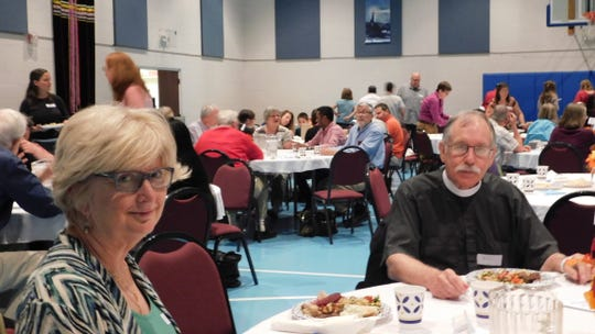 Deb Miller and Patrick Pierce were among the more than a hundred attendees at an Eid dinner Sunday evening at Central Presbyterian Church in Chambersburg. Members of the Jewish and Christian communities organized the dinner to show support for the Muslim community in Franklin County.