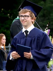 Dallastown Area High School graduate Cruz Mead walks with his diploma during commencement ceremonies at the school Wednesday, June 5, 2019. Failor's Photography