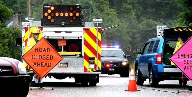 Fire police man a roadblock on Springwood Road at Camp Betty Washington Road after a vehicle accident Monday, June 10, 2019. Bill Kalina photo