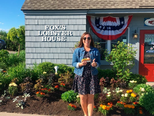 Alicia Jessop poses for a photo with a lobster roll at Fox's Lobster House in York, Maine. Jessop wanted to snap the perfect picture Friday of her lobster roll.