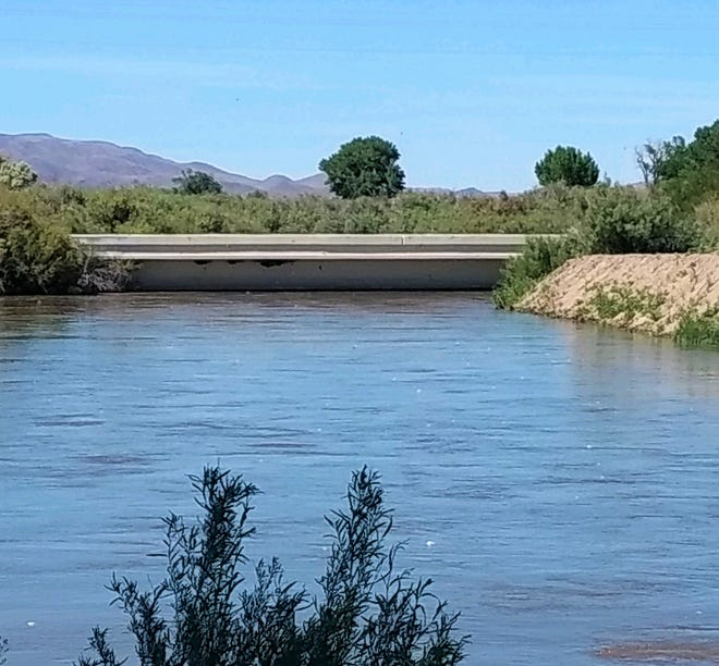 The Walker River is up to the bottom of the Miller Lane Bridge.