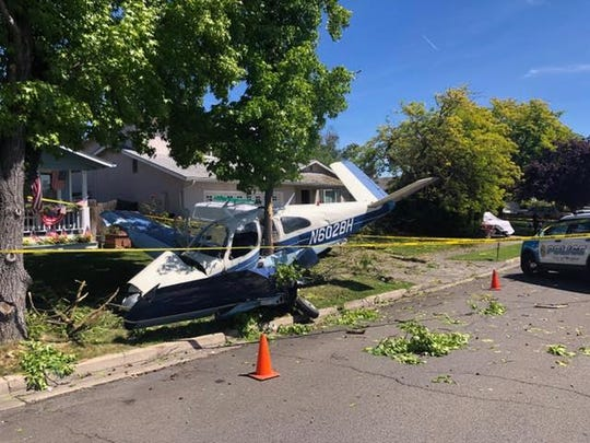 Two people from Boise were booked into jail on marijuana trafficking charges after crashing their plane in Medford.