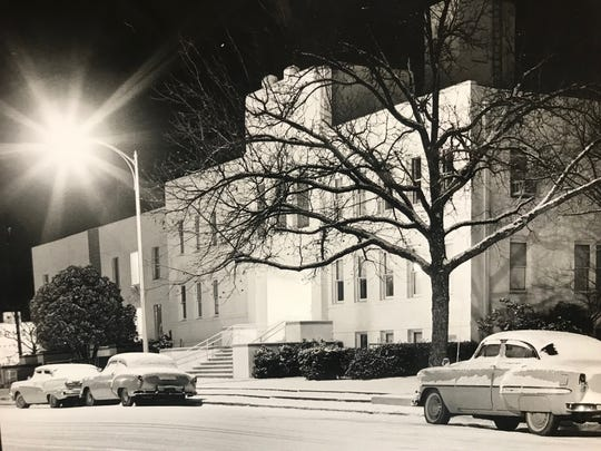 San Angelo Clinic Hospital is seen on a snowy night in 1961 in this Standard-Times file photo. The apartments standing in the far left of the image were built in 1910, and recently added to the dangerous buildings list.