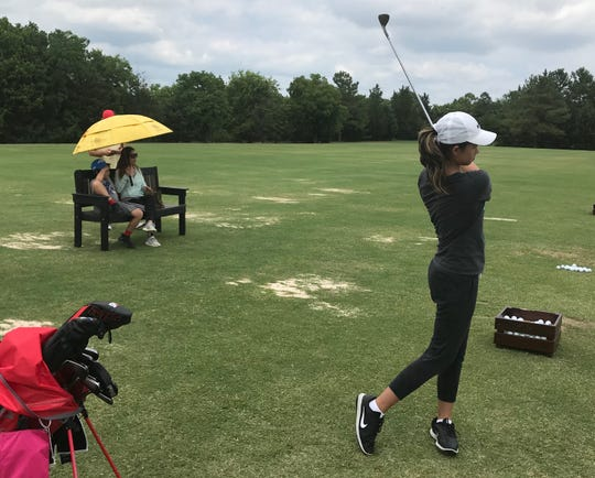 Thailand's Eila Galitsky, 12,  practices at David Toms Golf Academy as her family watches on Monday.