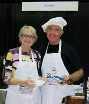 "Jane Hubbard and hubby Gentleman's Cooking  Classic Chairman John Hubbard served ""Unique Chili"" at their booth."