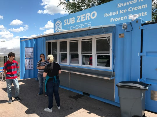 Jessica Rooney stands outside of Dakota Snow/Sub Zero Desserts at 501 E. 41st St. The frozen treat business opened its new stand in a converted shipping container.
