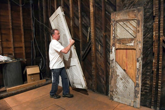 Scott Kraft pulls out the original doors from the old church on 14th Street on Monday morning, June 10.