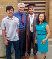 John and Ratthima Snider with their sons, far left, Jack Ryan Snider and, in cap and gown, John Robert Snider.
