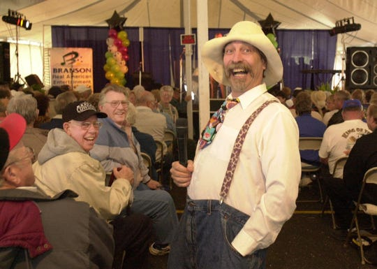 Wayne Milnes, an entertainer from 76 Music Hall, jokes around during a recess between shows at a 2001 Branson festival.