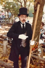 During the 1970s and 80s, Wayne Milnes played Mort the Mortician, also known as the Undertaker, in Silver Dollar City's street show.