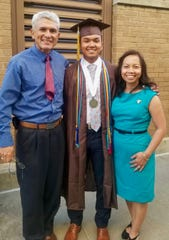 John and Ratthima Snider with their oldest son, John Robert Snider, at the Kickapoo High School graduation.