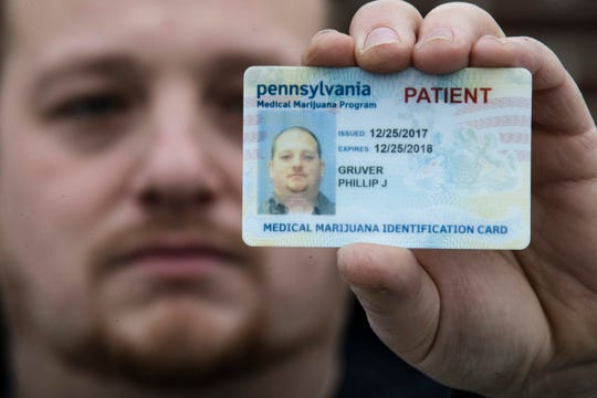 Pennsylvania medical marijuana identification card. In this Wednesday, Jan. 10, 2018 file photo, Phillip Gruver poses for a photograph with his Pennsylvania medical marijuana card.