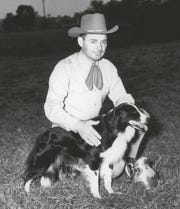 "The famed Arthur N. Allen of McLeansboro, Ill., poses with his border collie, ""Meg,"" after she took first place at the North American Sheep Dog Society national trials in Verona in 1946.The event drew more than 1,000 people."