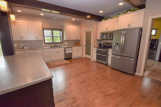 The kitchen is spacious and flows into the other rooms in the house.