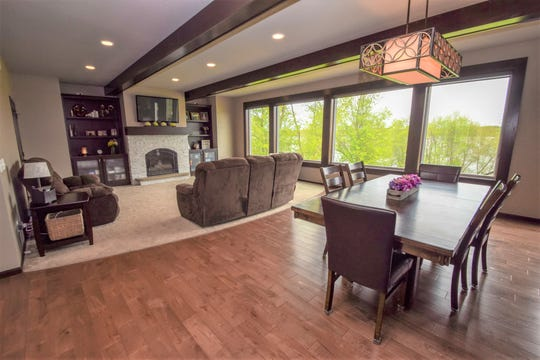 The floor plan creates an airy, relaxed openness that extends from the kitchen into the breakfast nook and informal dining room, then into the charming living room.