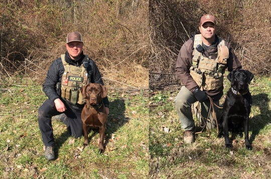 From left, conservation officers Josh Carver and Matt Burgess with their K9s, Carlo and Cruz.