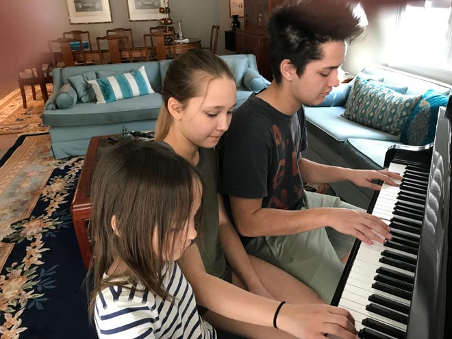 Yale, India and Emme Abernathy make music together at home in St. George.