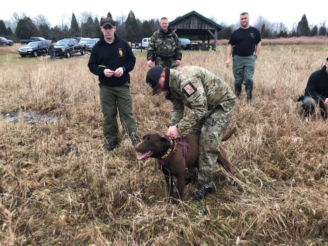 A Utah DWR officer undergoes K9 training with his dog.
