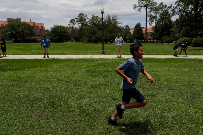 Fidencio Gonzalez, 12, plays rock, paper, scissors relay during the Florida State University College of Social Work's Arts and Athletics Camp Monday, June 10, 2019.