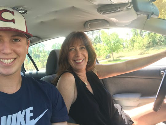 Leslie Smith and her son Cooper, who rode in a baby seat and learned to drive in the Honda