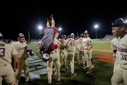 Florida State celebrates after defeating LSU in 12 innings in Game 2 of the NCAA college baseball super regional tournament in Baton Rouge, La., Sunday, June 9, 2019. Florida State won 5-4 to advance to the College World Series. (AP Photo/Gerald Herbert)