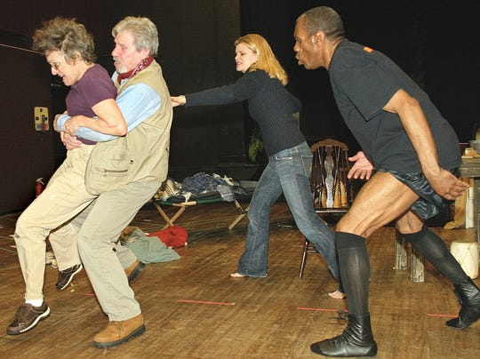 "Phyllis Freilich, Robert Walden, Heather Tom and Andre De Shields (far right) rehearse a scene from the play ""Prymate,"" which premiered FSU's ""Seven Days of Opening Nights"" in February 2004."