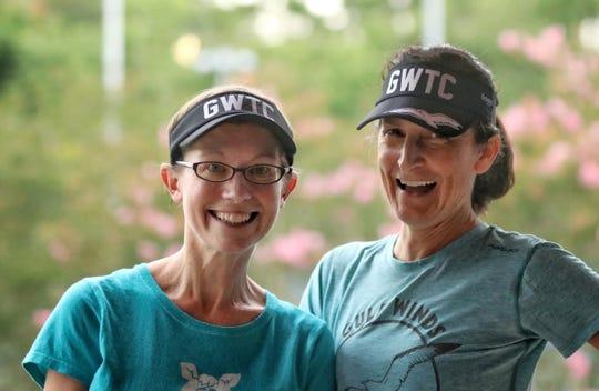 Laura McDermott and Paula O'Neal celebrate Pot Luck fun.