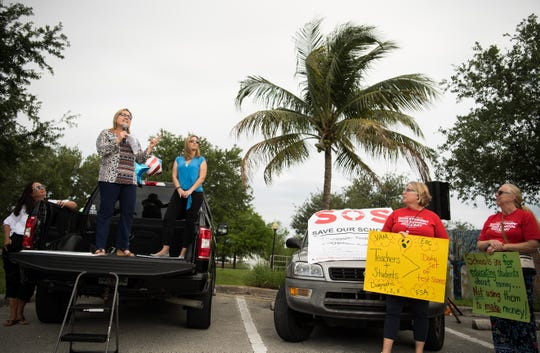 "Stuart resident Tina McSoley, a parent and former Martin County School Board member who founded Reconstruct-ED of Stuart, speaks to a crowd of hundreds gathered to march in support of reforms to Florida's public education system Wednesday, May 15, 2019, in Stuart. ""This is the beginning of an eight-month program to educate Florida on education,"" she said. ""There's a lot of work to be done statewide, and I believe most of our issues come from mandates from Tallahassee,"" she added, ""and until we get Tallahassee's attention, our hands are tied locally."""
