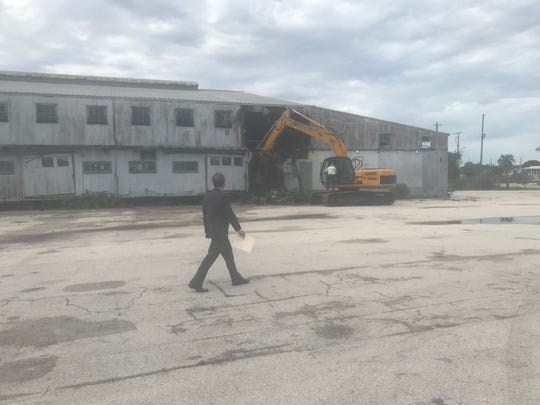 St. Lucie County Seaport Director Stan Payne on June 10, 2019 walks by former citrus packinghouse at the Port of Fort Pierce. The building is being demolished to make way for development of Derecktor Ft. Pierce, a mega-yacht refit center at the port.