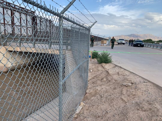 Police investigate the site where three bodies were found Monday morning, June 10, 2019, in a water tunnel near the U.S.-Mexico border in El Paso.