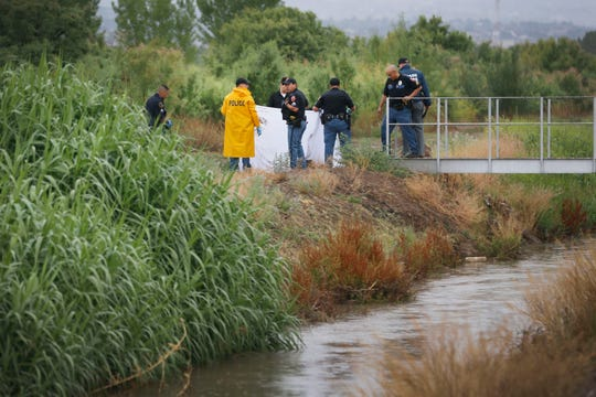 El Paso police examine the body of a man found in a canal Monday in the Upper Valley.