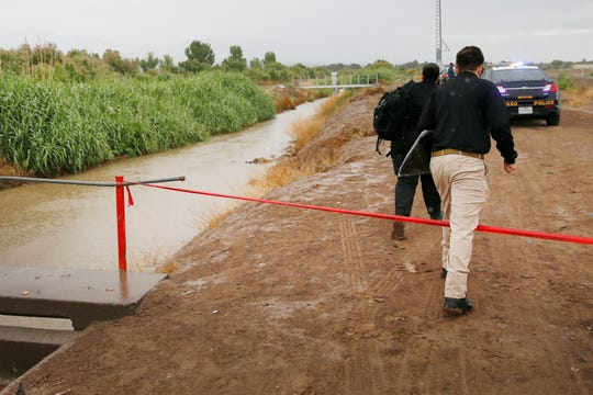 Medical examiners arrive at the Union Lateral Canal in the 6000 block of Upper Valley Road to examine the body of a man that was found in the canal Monday, June 10, 2019, in El Paso's Upper Valley.