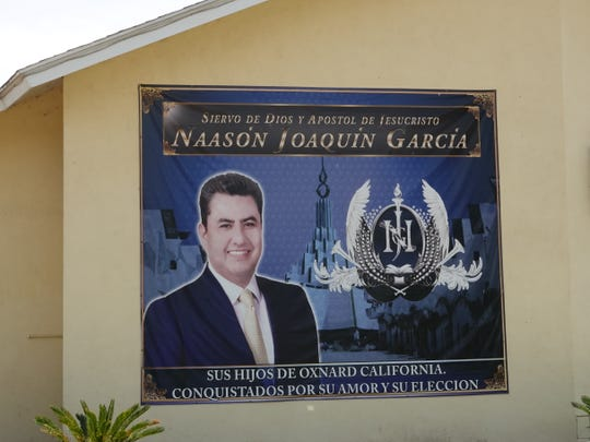 A sign with Naasón Joaquín García's name and image adorns the front of La Luz del Mundo church in Nyeland Acres. Garcia, who leads the Mexico-based church, was arrested in Los Angeles June 3 and has been charged with child sex crimes.