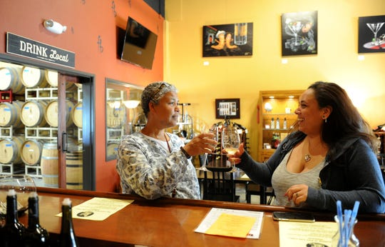 Tina Perry, left, and daughter Caitlyn Williams toast one another while tasting wine at Four Brix Winery in Ventura. Located in an Eastman Avenue business park, the winery this month is launching a hard-cider label called Pier City Cider.