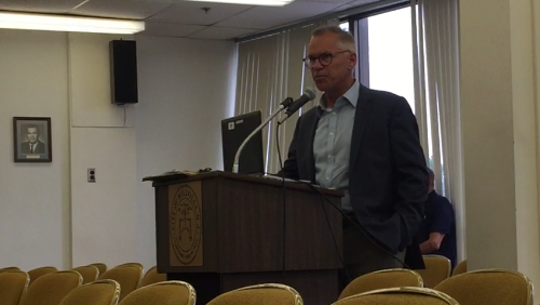 Bernhard Capital Partners Operating Partner Ron DeGregorio talks to millville commissioners on June 5 after a deal to front the city money using operational control of its water and sewer utilities as collateral.