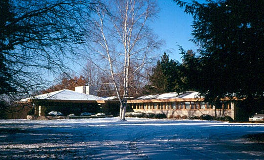 An exterior photo of the Frank Lloyd Wright-designed home at 904 Grand Avenue. The home is now used as corporate offices for Midwest Communications.