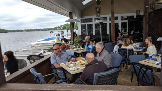 Dockside diners enjoy a meal by Lake Mahopac.